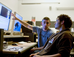 Two students in a computer lab