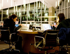 Photo of students working in the Lewis Library at night