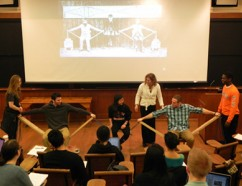 Princeton engineering students demonstrate how a cantilever bridge carries loads.