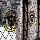 Stained glass window with Princeton shields