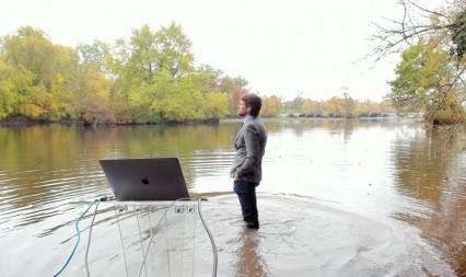 Professor Robert Pringle standing in lake teaching class