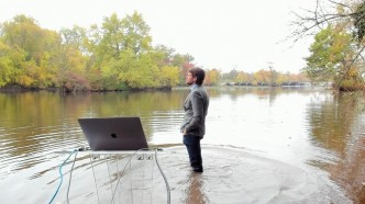 Professor Robert Pringle standing in lake teaching class